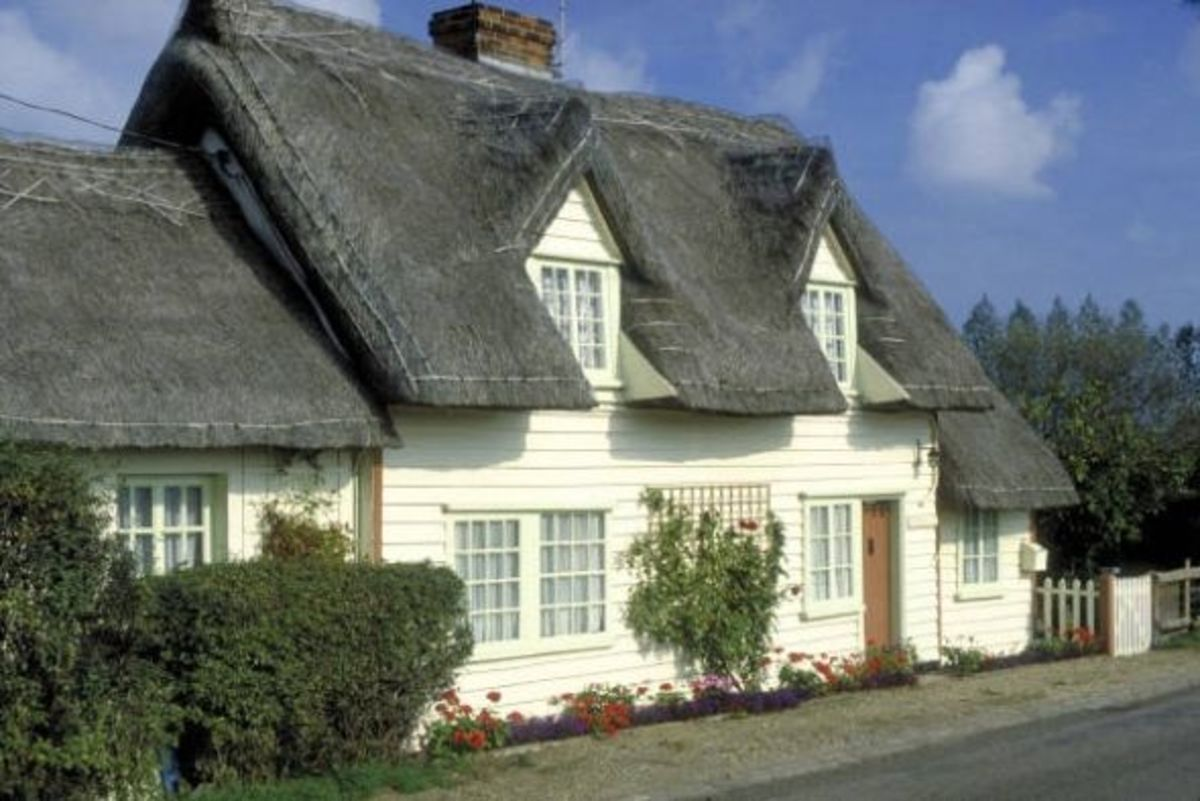 A White Cottage with a Thatched Roof
