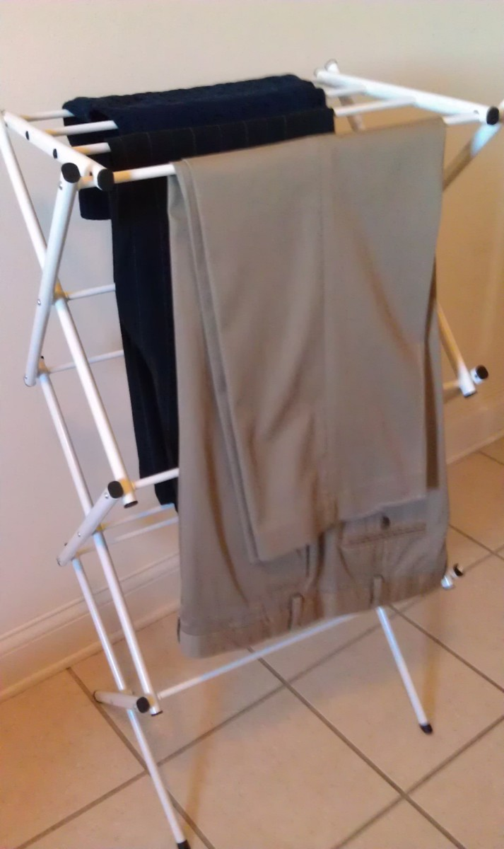Hang damp trousers on a laundry rack and smooth out the wrinkles.  If you like a front crease, pinch and smooth with your fingers.  Let dry and no iron needed!