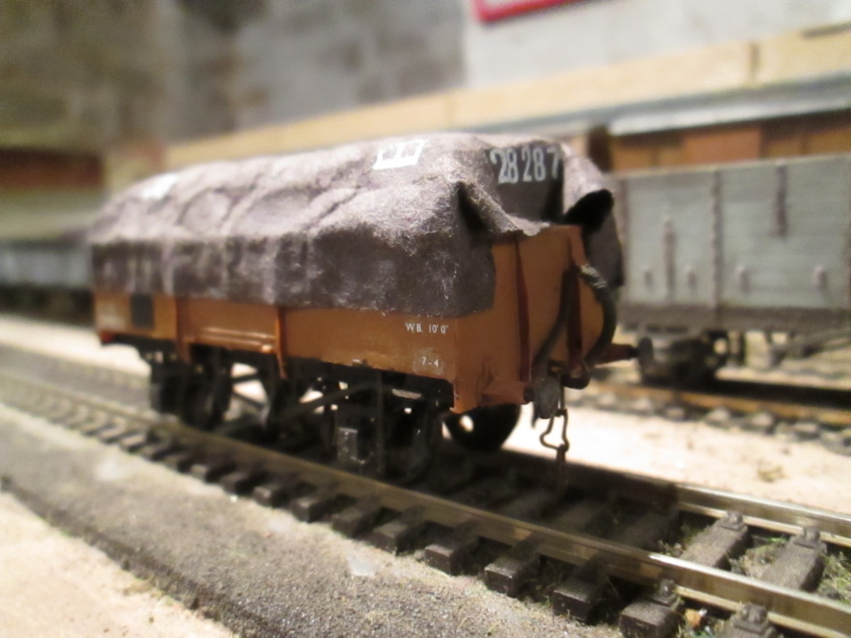 'Tarpaulined' Steel-bodied 13 ton ex-LNER open (Parkside kit - I have several different types with tarpaulins fixed permanently over plastic formes)  Block of plastic under the tarpaulin is enough for the illusion to work.