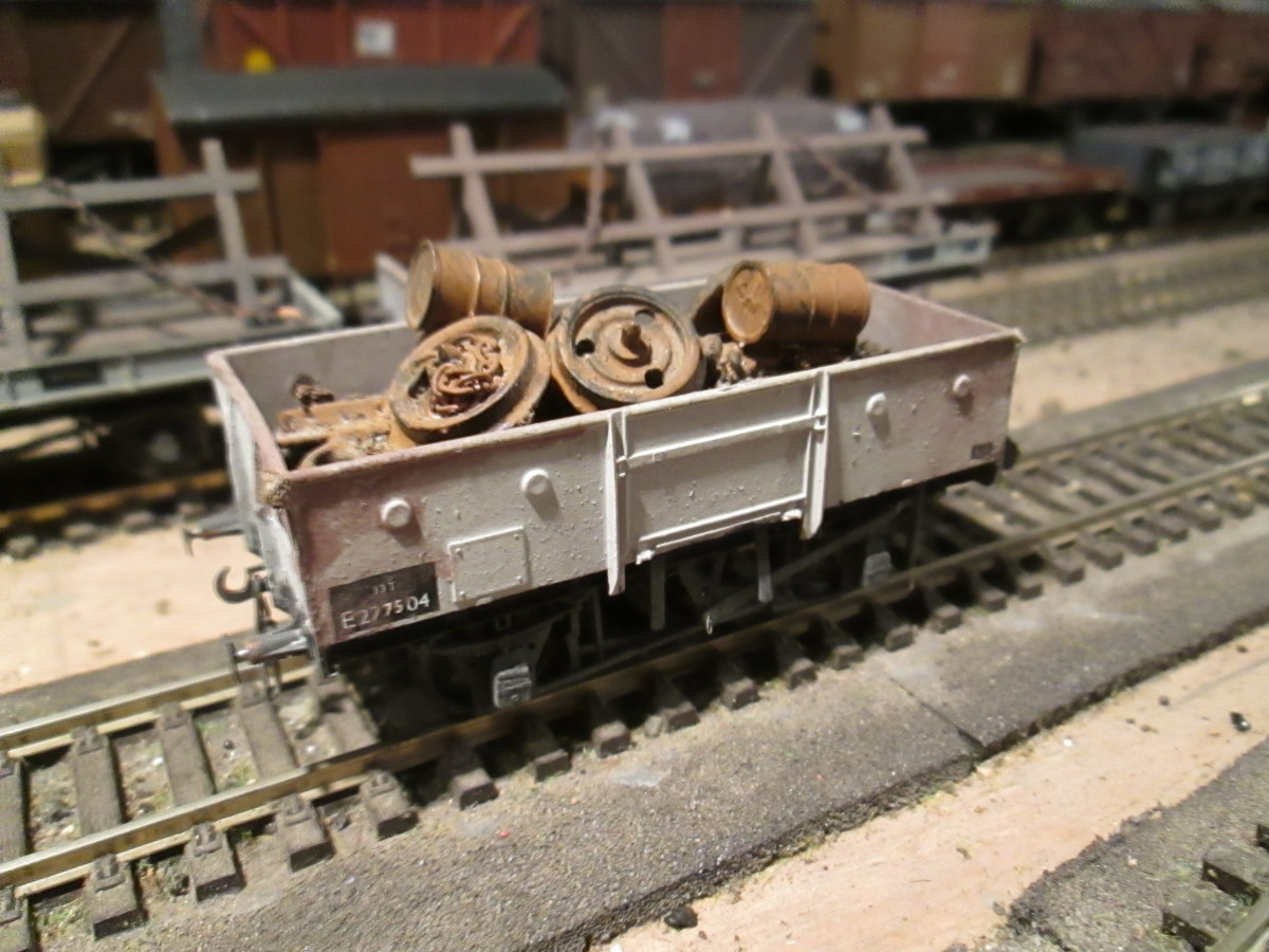 The unfitted version with railway scrap load  - the LNER built many of these wagons without vacuum brake cylinders and clasp brakes, putting Morton type on instead. Parkside kit modified with Morton Brake detailing. Weathered plastic load
