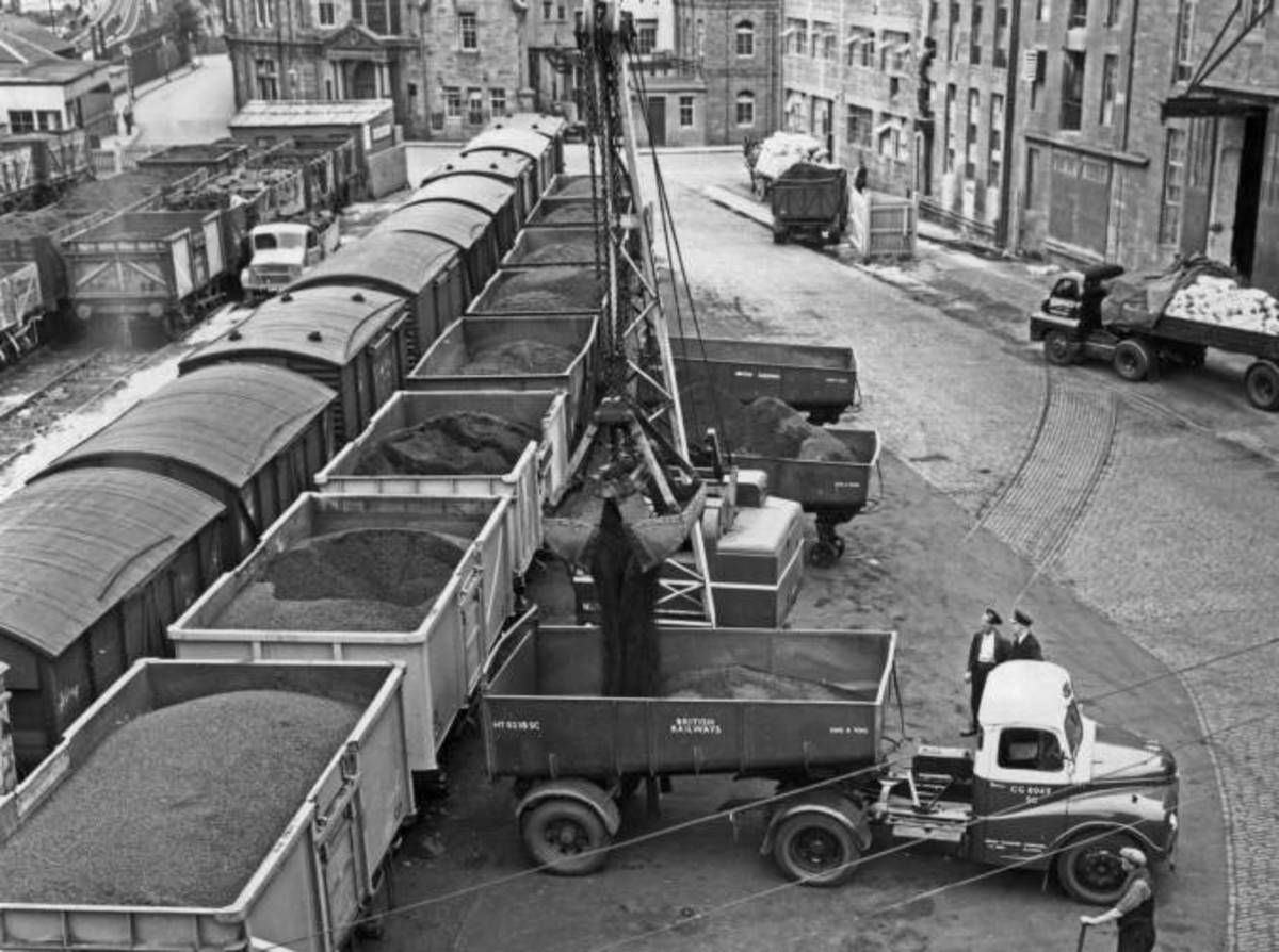 Unloading wagons at a goods depot, 1960s - not a hi-viz jacket or health & safety rep in sight!