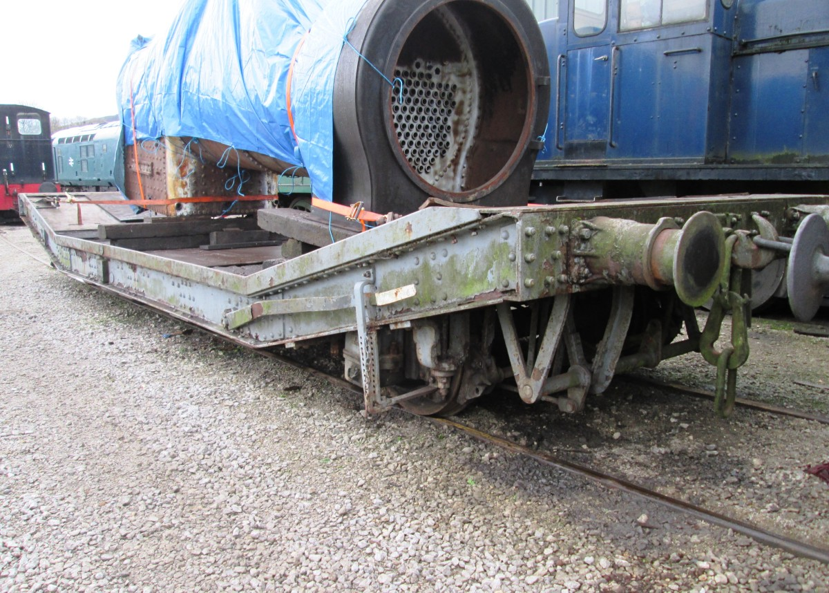 Briitish Railways machine wagon with instanter coupling and vacuum pipe; loaded with small tarpaulined locomotive boiler load seen at Embsay Station near Skipton on the Embsay & Bolton Abbey Railway in North Yorkshire (formerly West Riding)