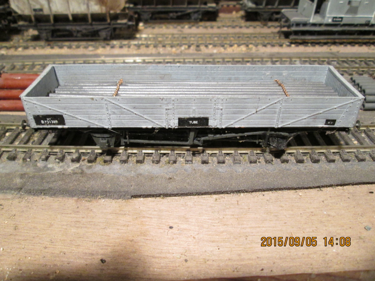 Another drop-sided, long wheelbase four-wheeled BR Tube Wagon - painted and chained 4mm aluminium tube load represents steel tube in this Parkside wagon (fine 2mm scale chain from Eileen's Emporium)