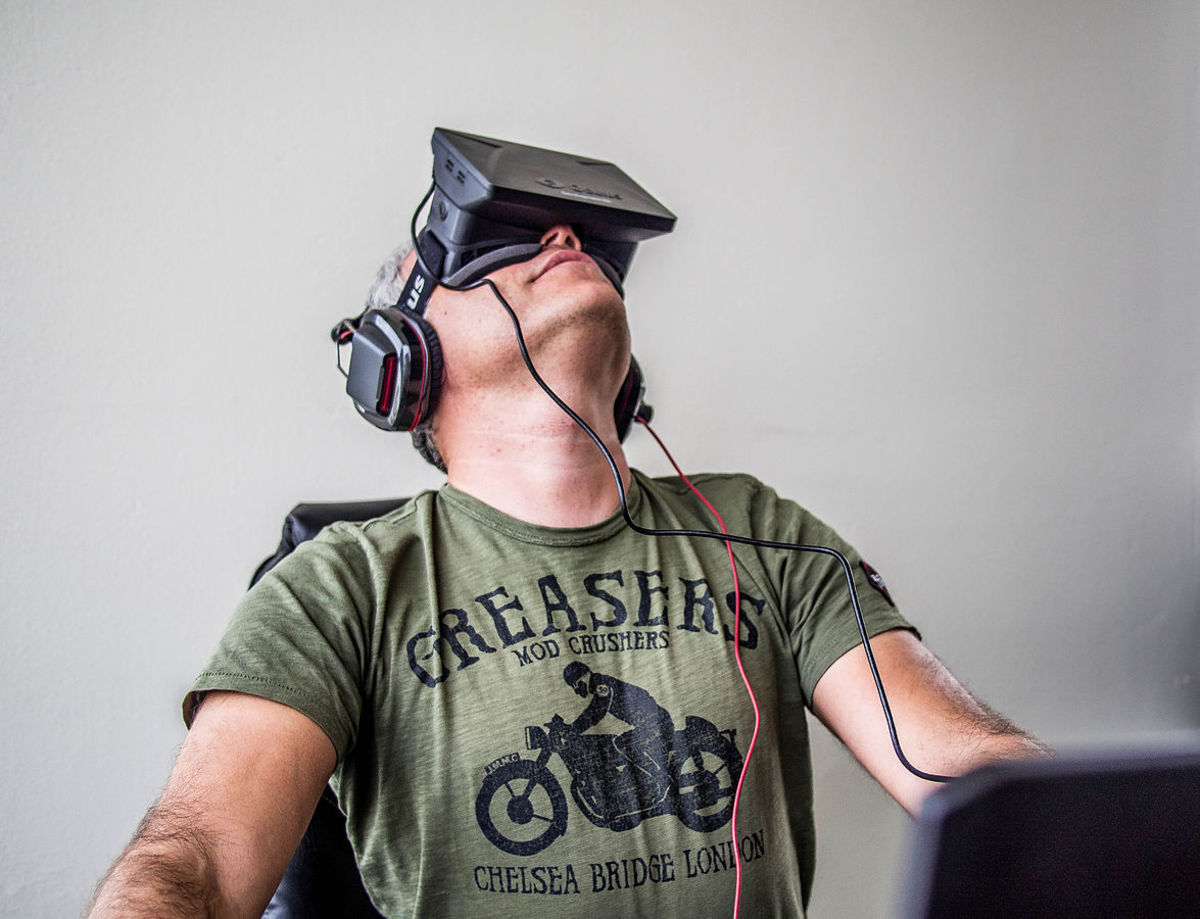 Game designer Sergey Orlovskiy using an early Oculus Rift VR headset.