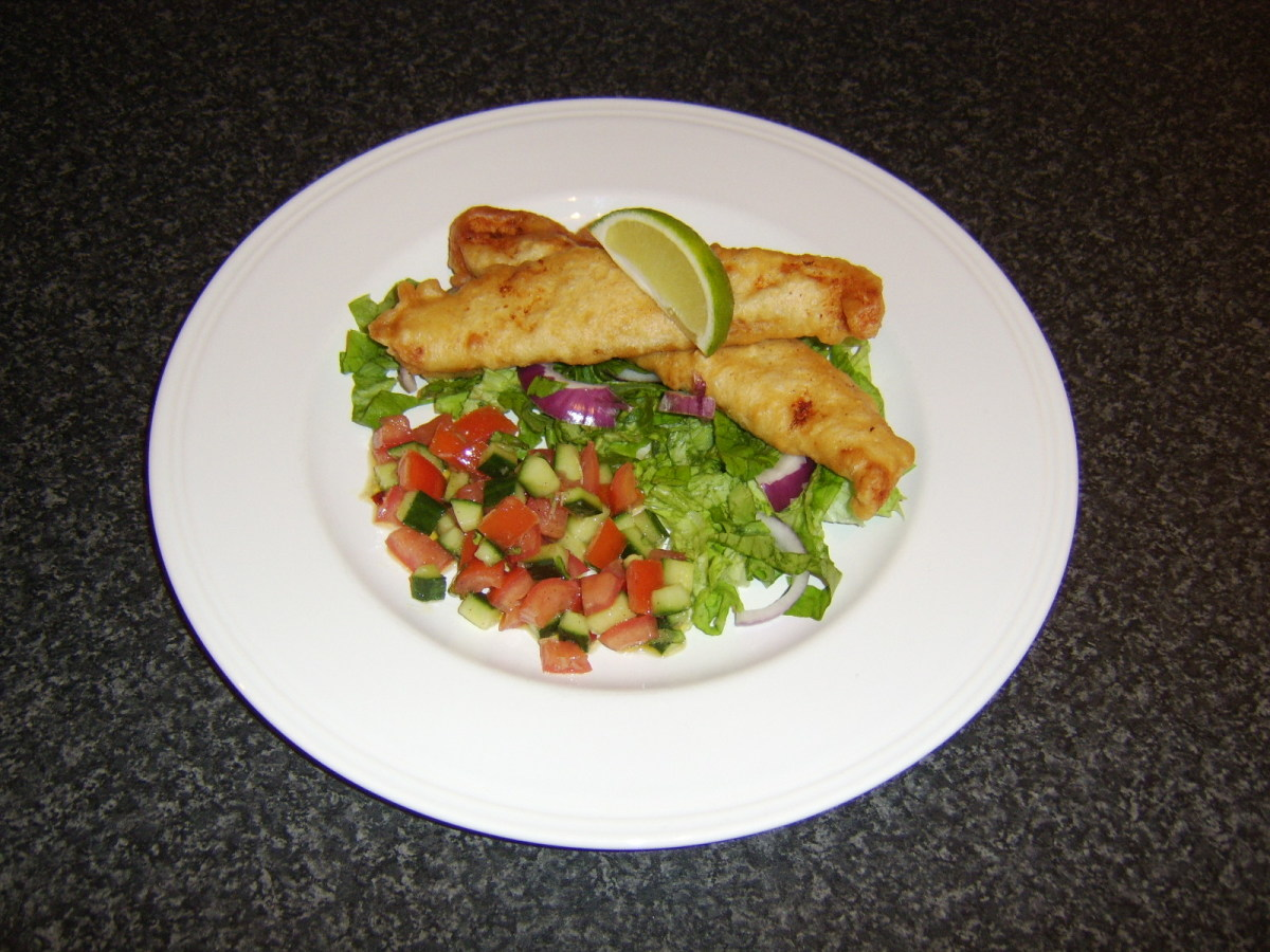 Battered and deep fried fillets of basa fish with salad