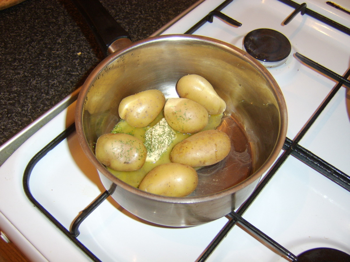 Butter and dill are added to the drained potatoes while the pie topping is toasting