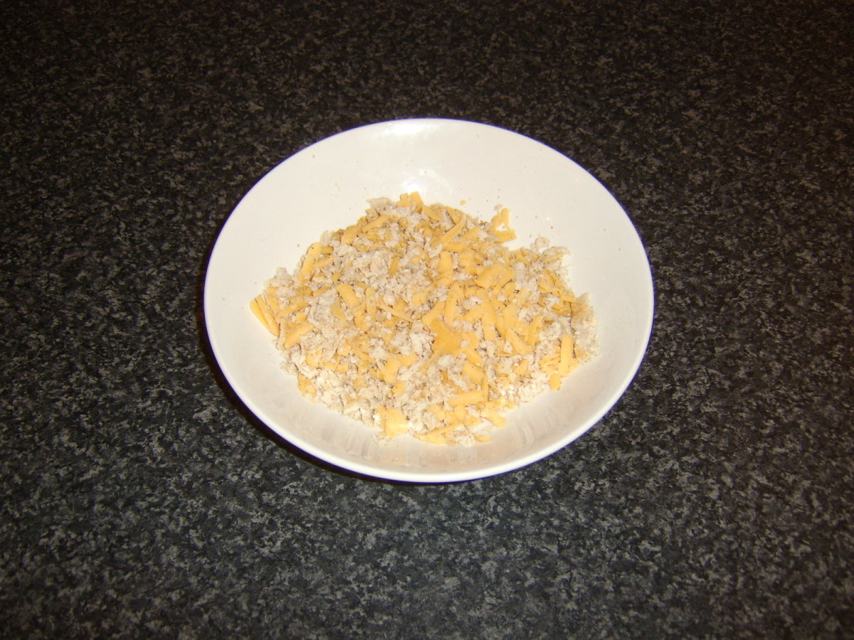 Bread and cheese are grated, seasoned and mixed
