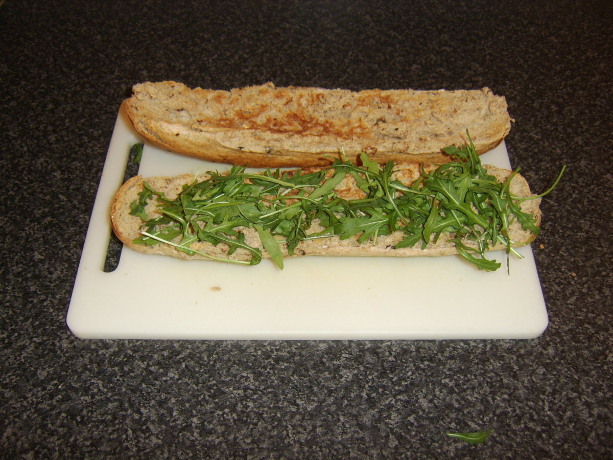 Rocket leaves/arugula is firstly laid on the bottom half of the bread