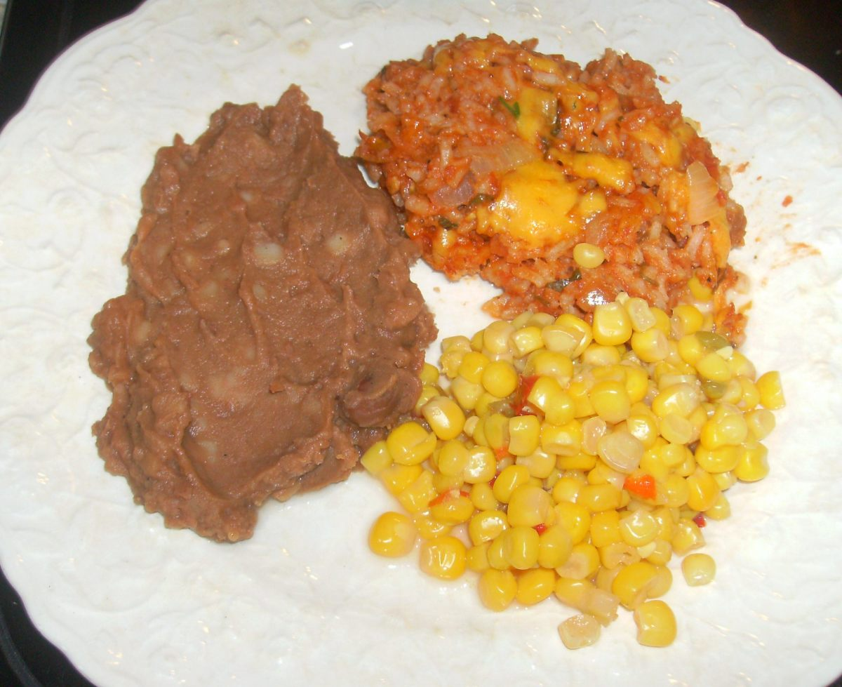Mexican rice goes well with refried beans and Mexican style corn.