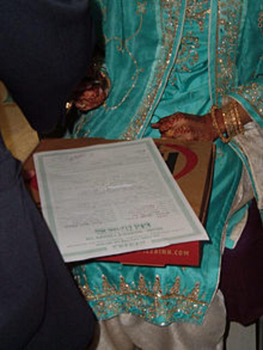 bride is signing Nikkah namaa.
