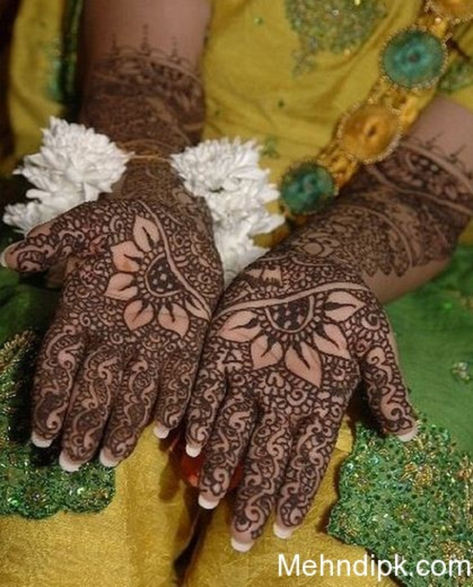 floral mehndi(hina) on bride's hands.