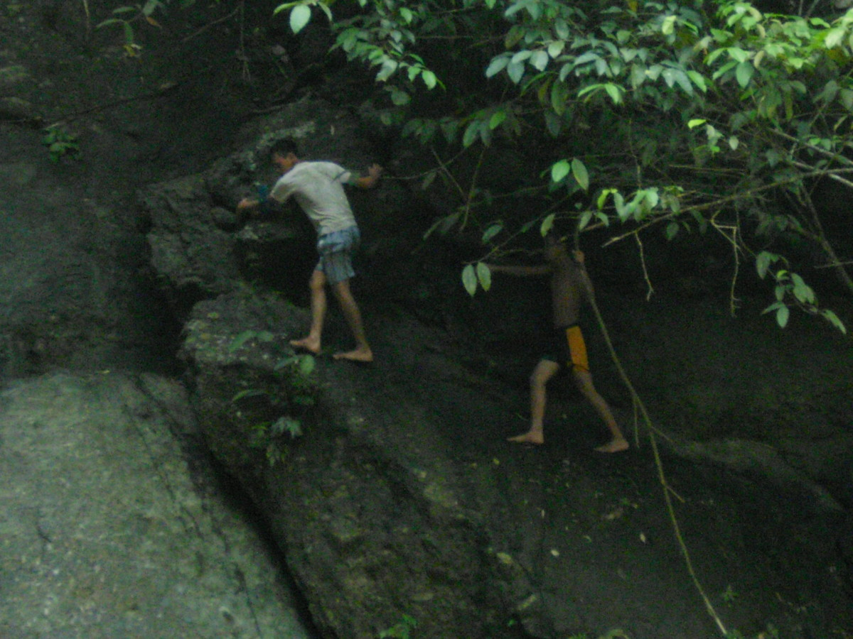 My nephews climbing to the top of Busay Waterfalls with their bare hands.