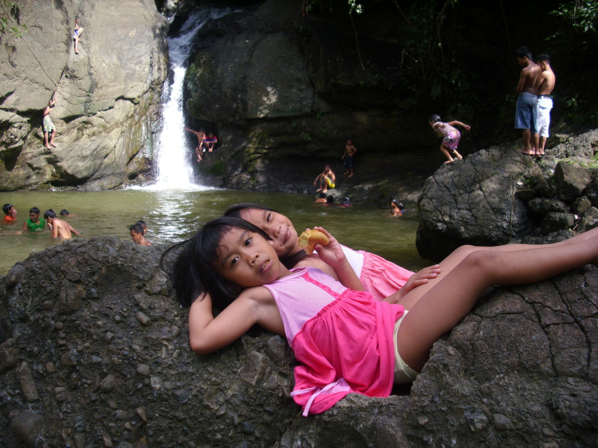 My nieces relaxing at Busay Waterfalls.
