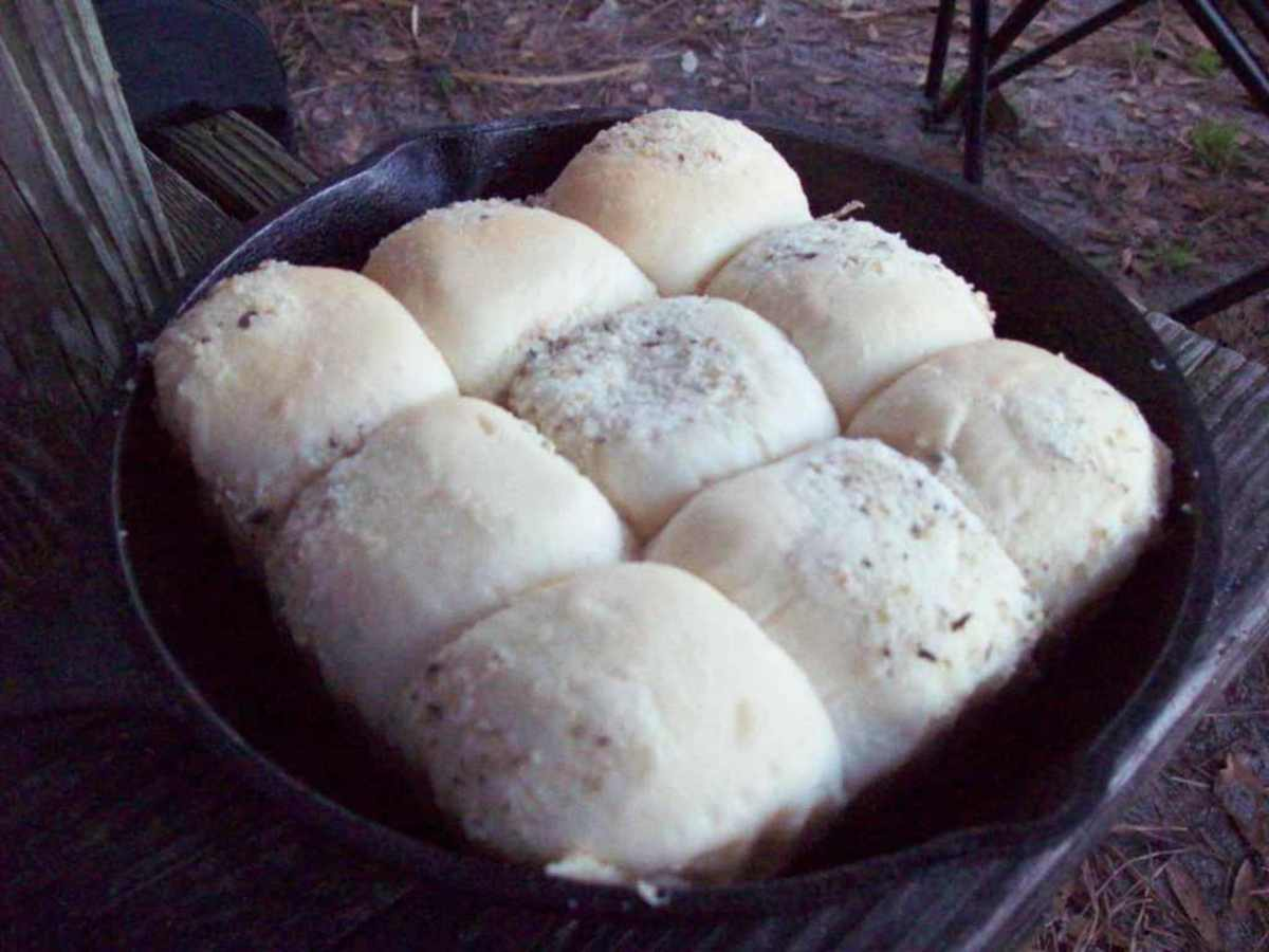 Take the rolls out of their foil pan and place into skillet.  Cover before putting them on the coals.