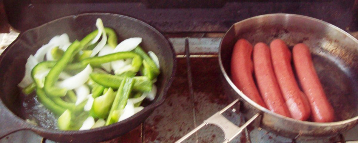 Sautee the onions and peppers at the same time as you are cooking the hot dogs.  Then heat the chili beans in a separate pan.