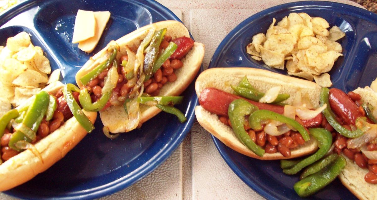 Yummy chili hot dogs with a side of salt and vinegar kettle chips.