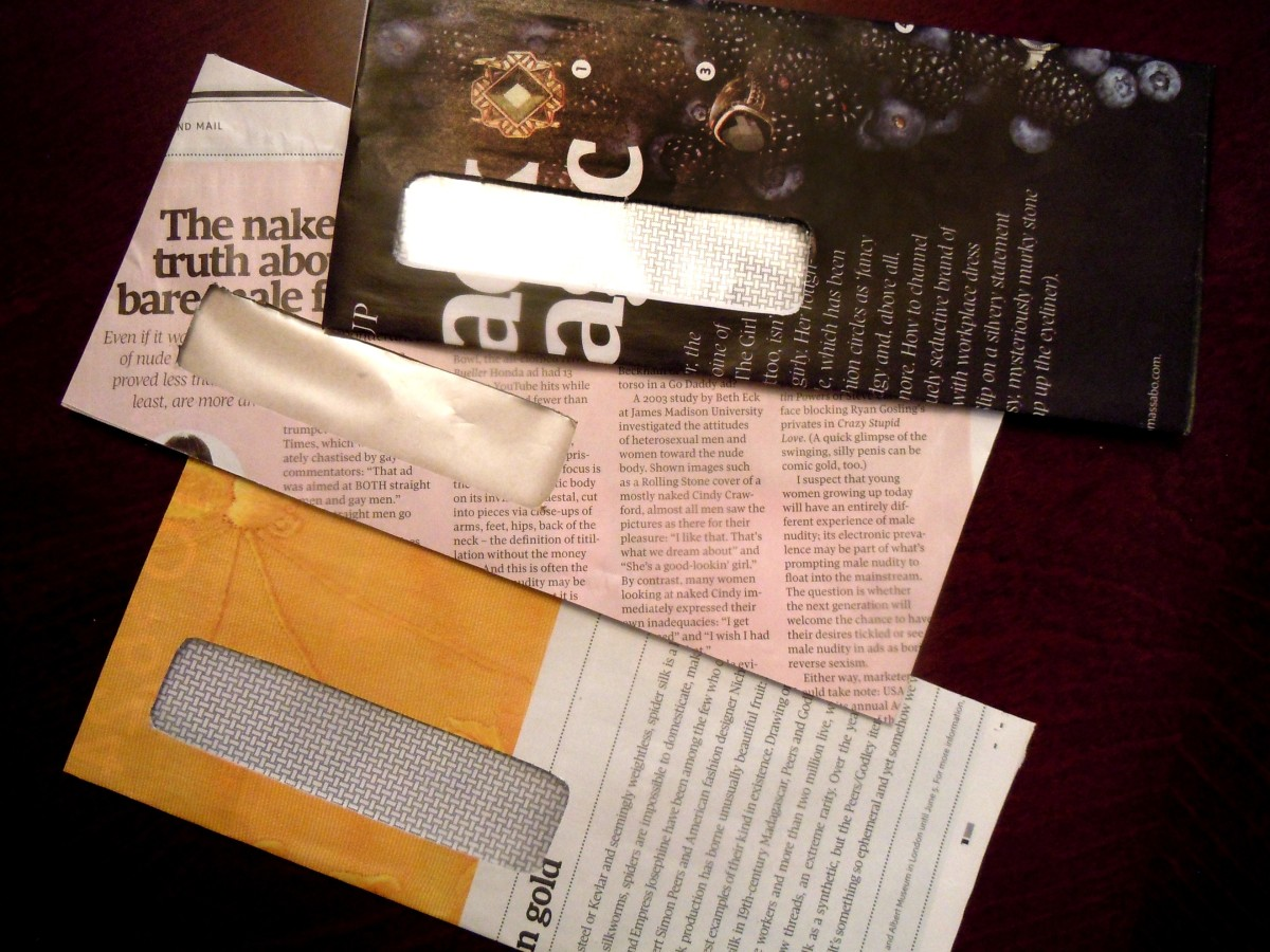 Samples of reused window envelopes crafted with glossy newspaper ads and articles.