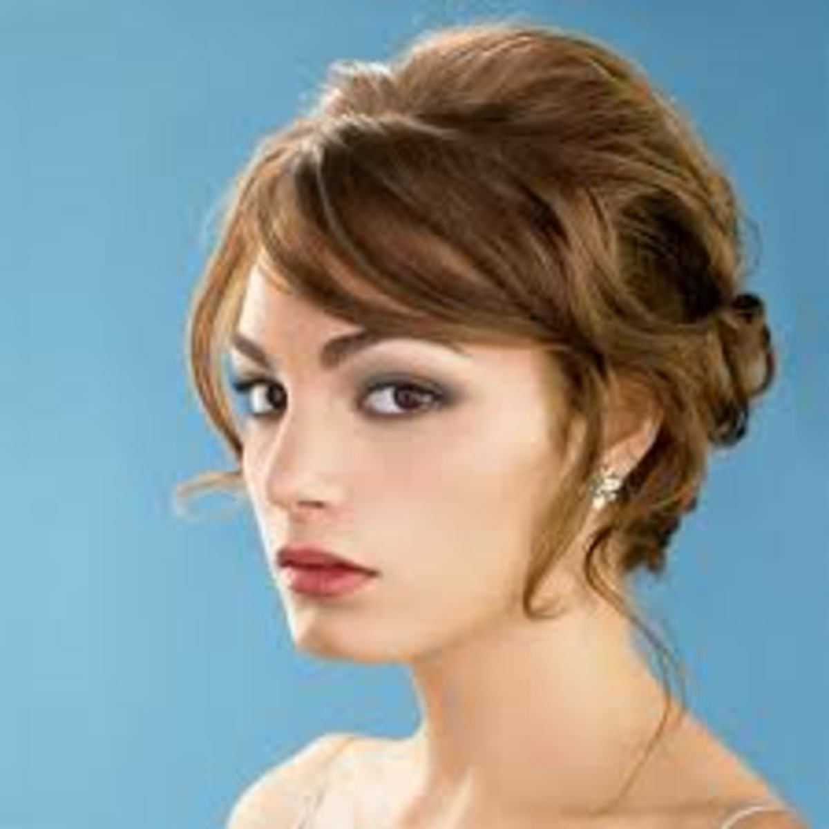 Lots of volume helps hide where shorter strands of hair have been pinned back.
