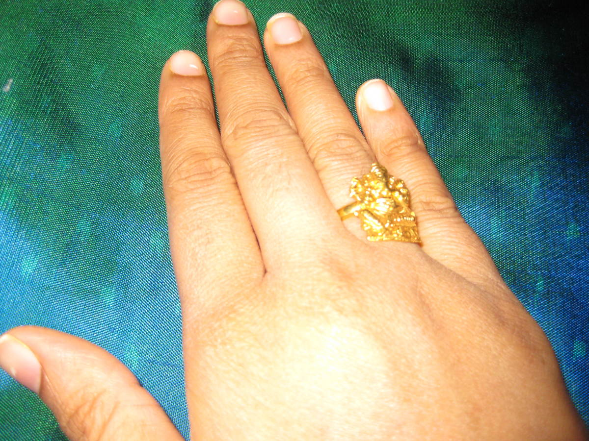 A temple ring with Ganesha, Indian god of good luck attached to it