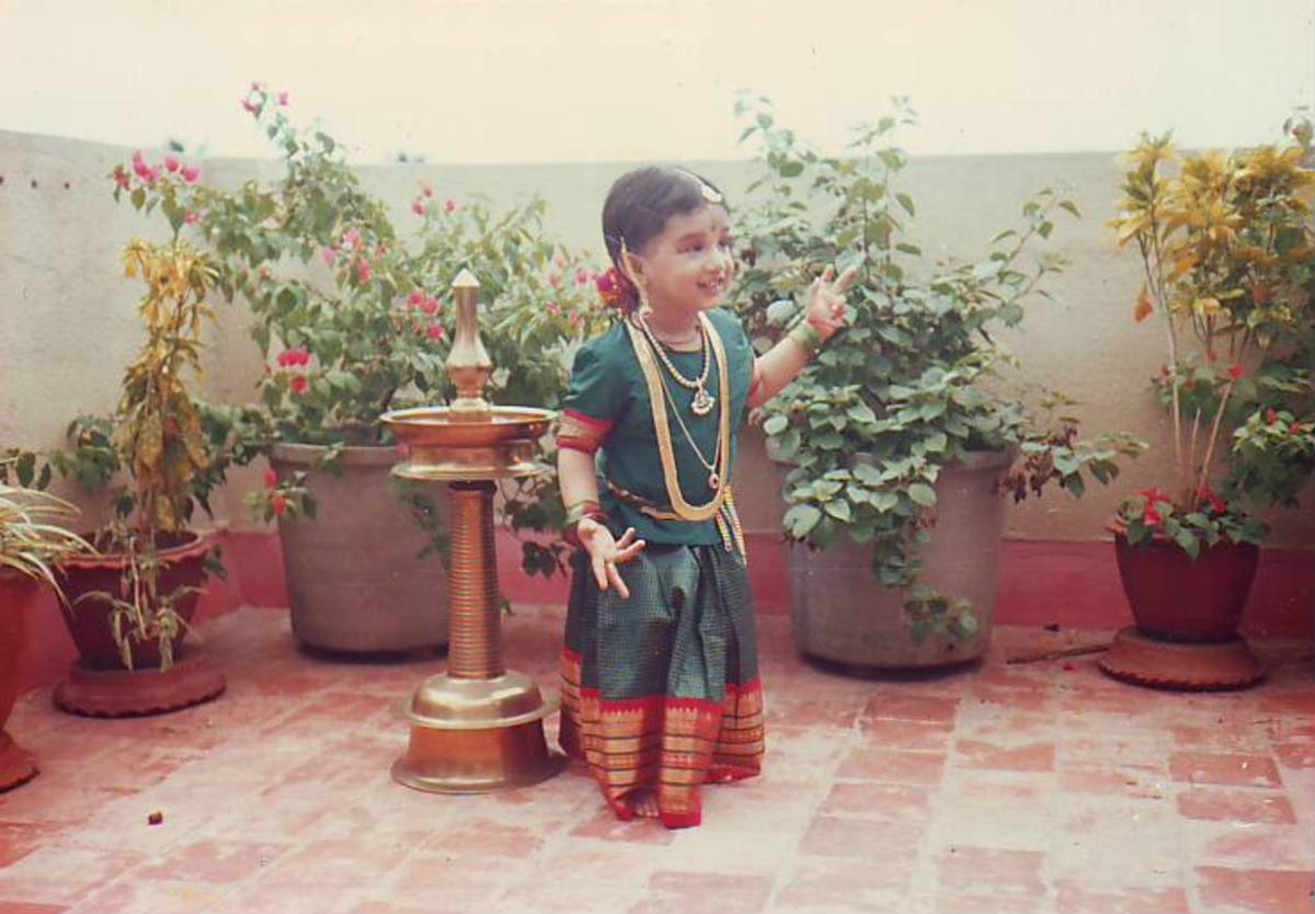 This is me as a three years old child wearing Indian silk dress and temple jewelry including the pair of earrings, coin chain, necklace, waist belt, hip chain and bangles