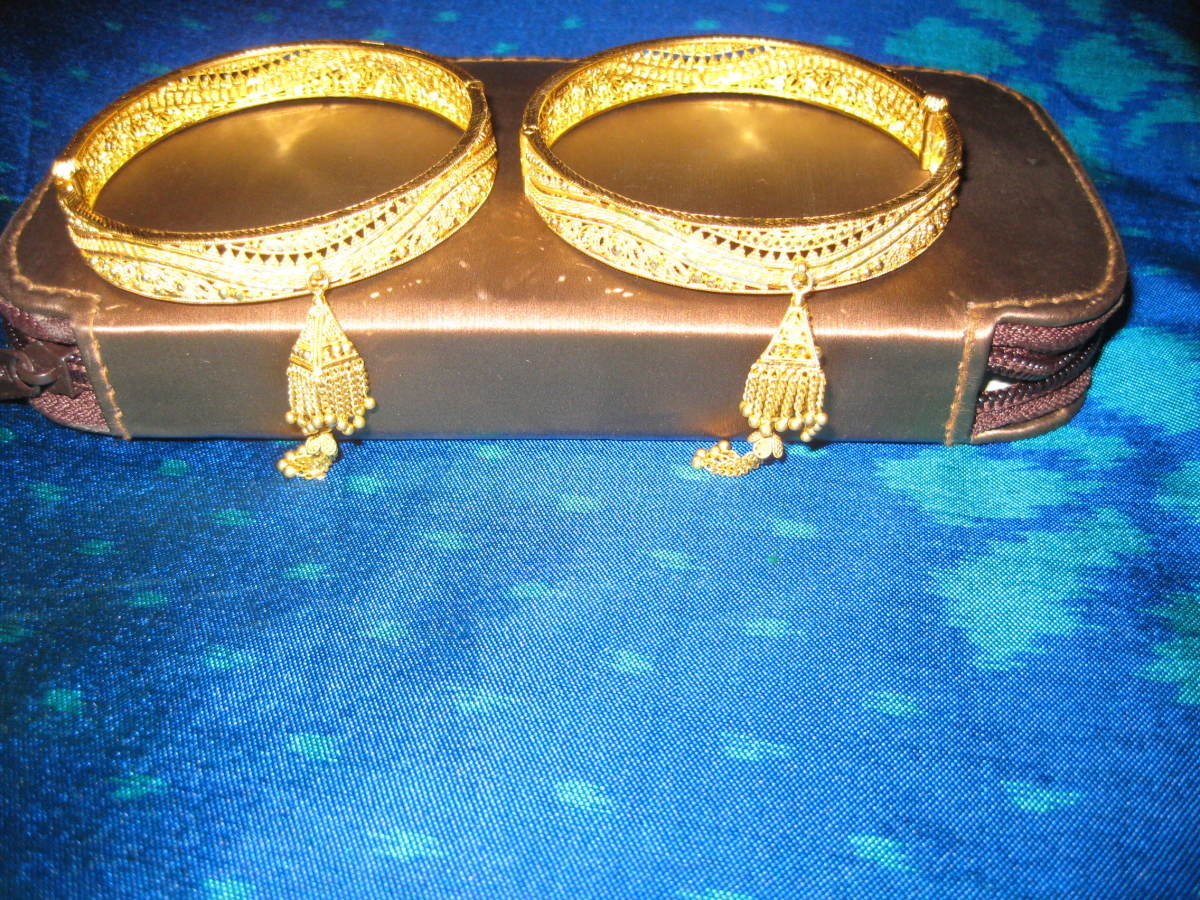 A pair of temple bangles with little bells attached to them