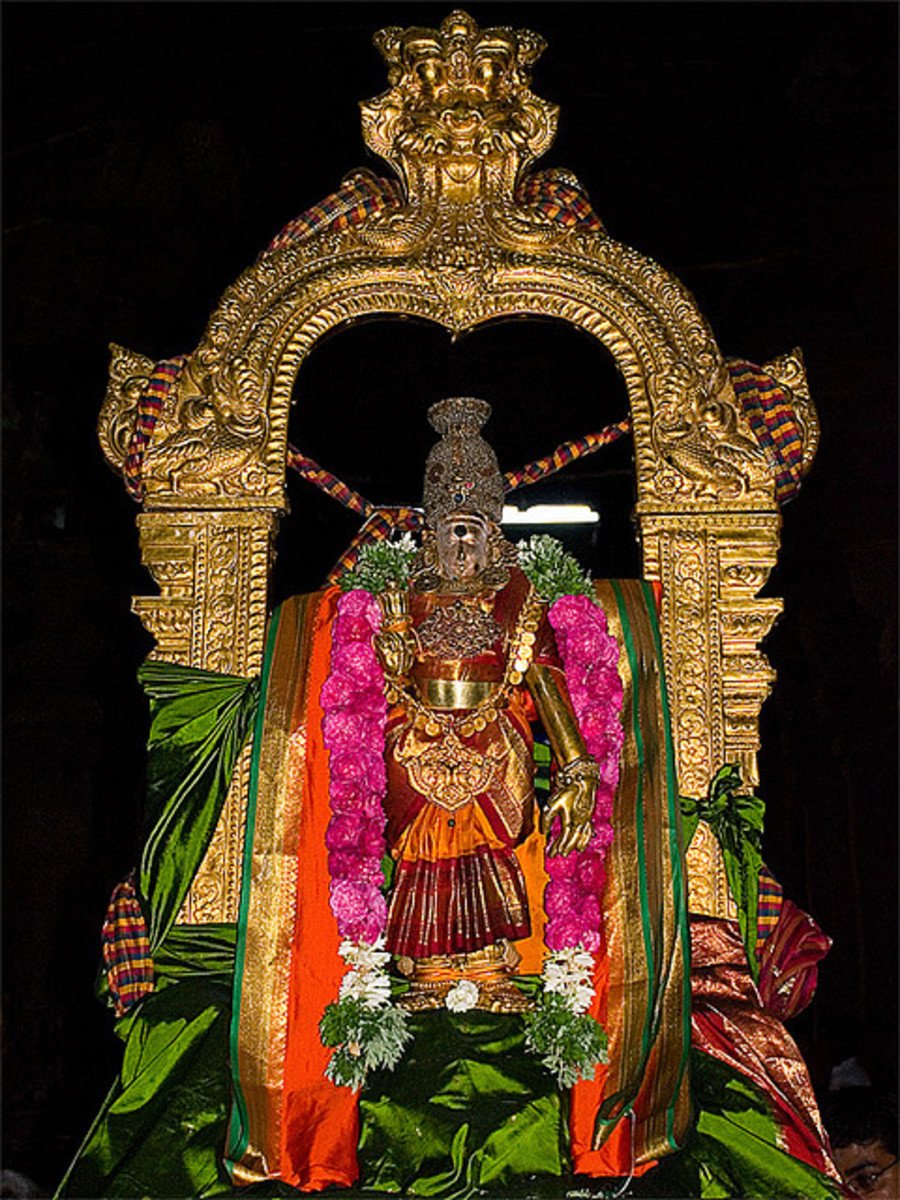 Indian Goddess Meenakshi  is adorned with temple jewelry at a temple in Karpagragam, Tamil Nadu in South India.