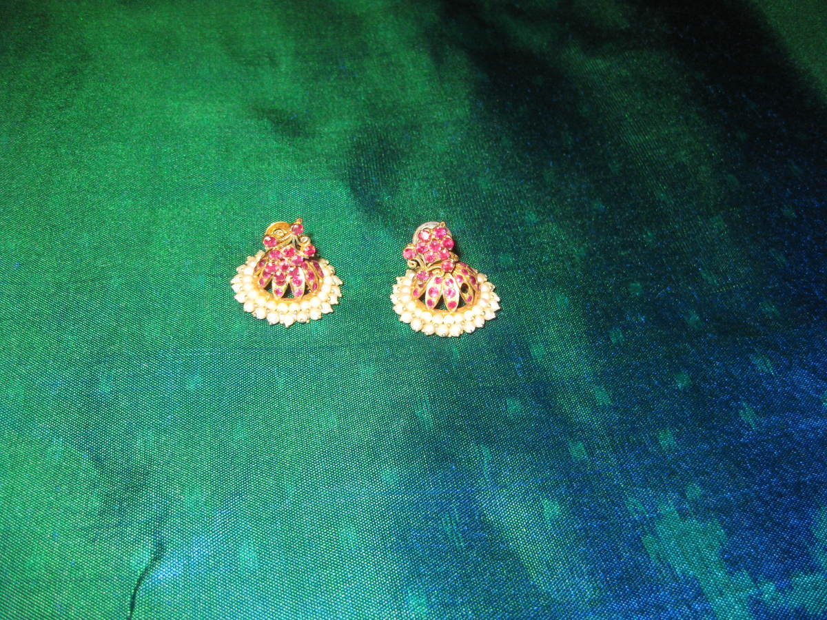 A pair of temple bell-shaped earrings