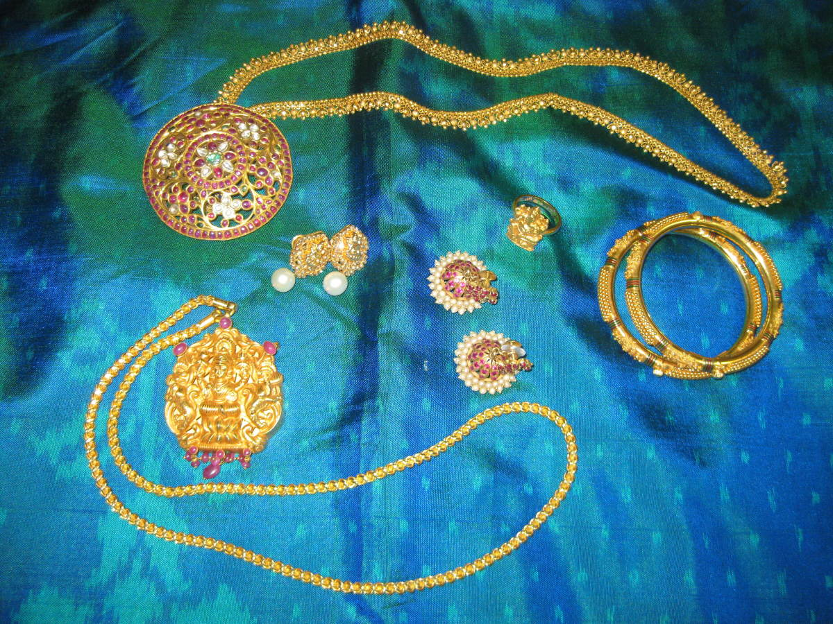 Temple jewelry included a chain, necklace, two pairs of earrings, bangles and ring with a silk saree as the background