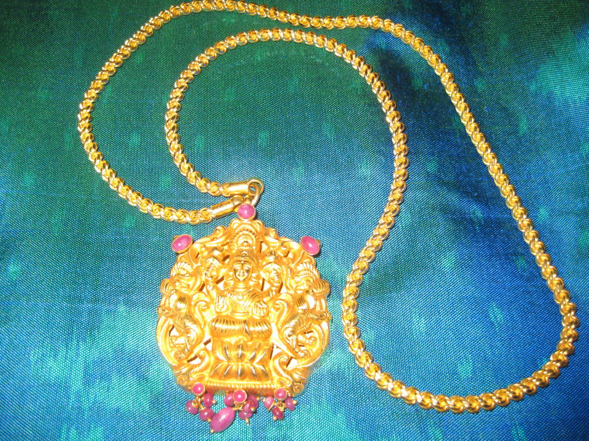 A necklace with the pendant of Lakshmi, Indian goddess of wealth