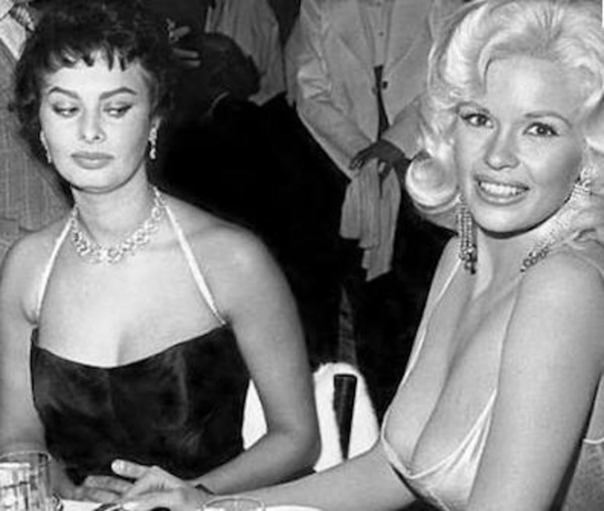 1957-Sophia Loren spies at Jayne Mansfield breasts- before implants existed.