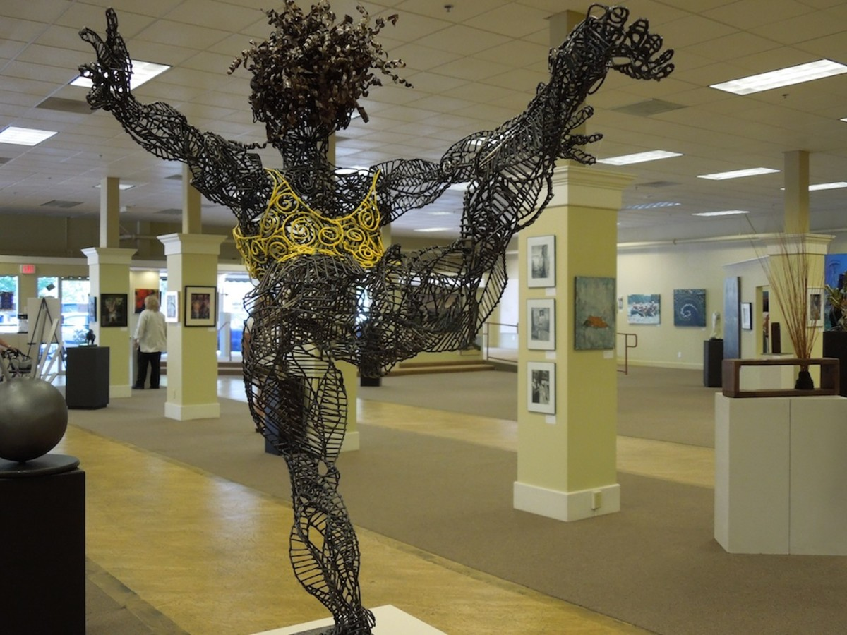 """Yellow Girl"" by Eveny Zirul, welded steel and recycled clothes"