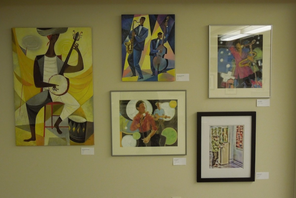 """This wall was mostly devoted to a music theme. On the Left, """"Calypso"""" by Andre (Igor) Rostowski, who also did """"Rhythm and Blues"""" at top center, both in acrylic. Sally Tippman did """"Club Date"""" (center bottom) and """"Sound Machine""""  (top right)."""