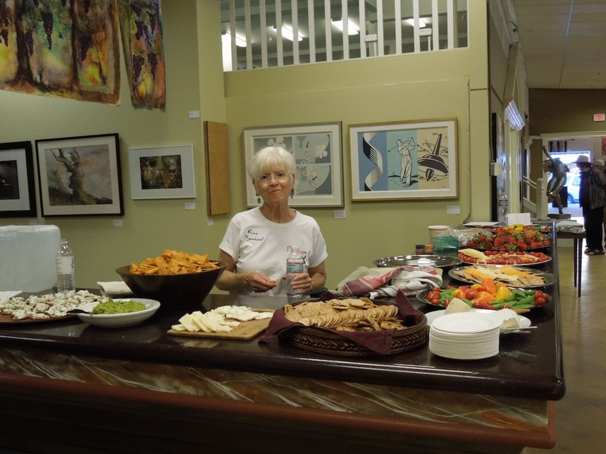 The artists provided and served this delicious buffet. Later on, they replenished it with desert foods. It was much appreciated by all. Don't forget to notice the banners hanging on the left above the buffet.