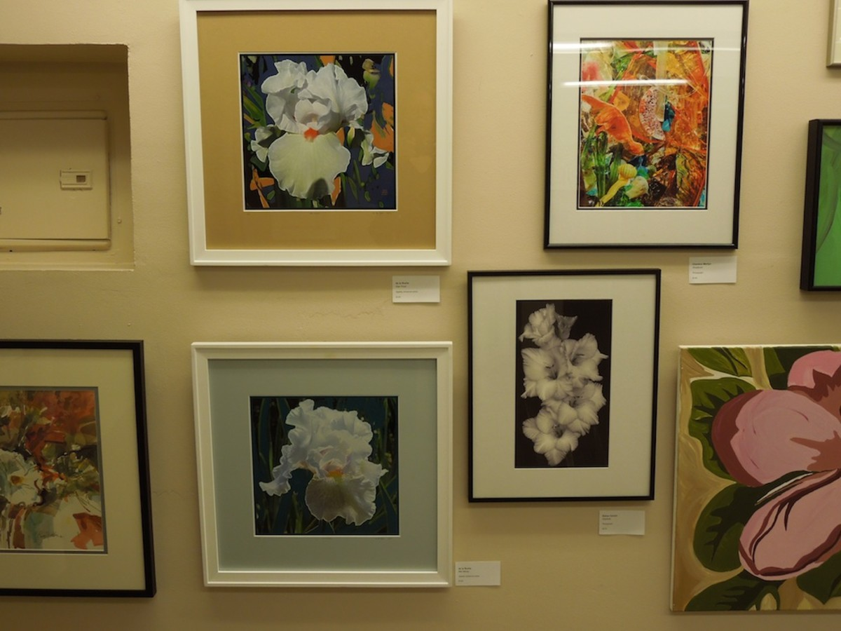 This wall of art was a bouquet of floral pictures. Where I have the name of the artists, they are in the text to the left.