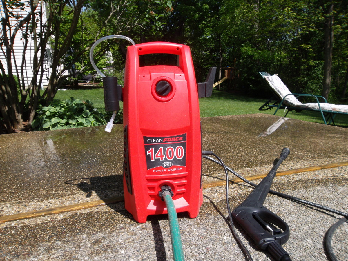 Use an electric pressure washer to clean a concrete patio