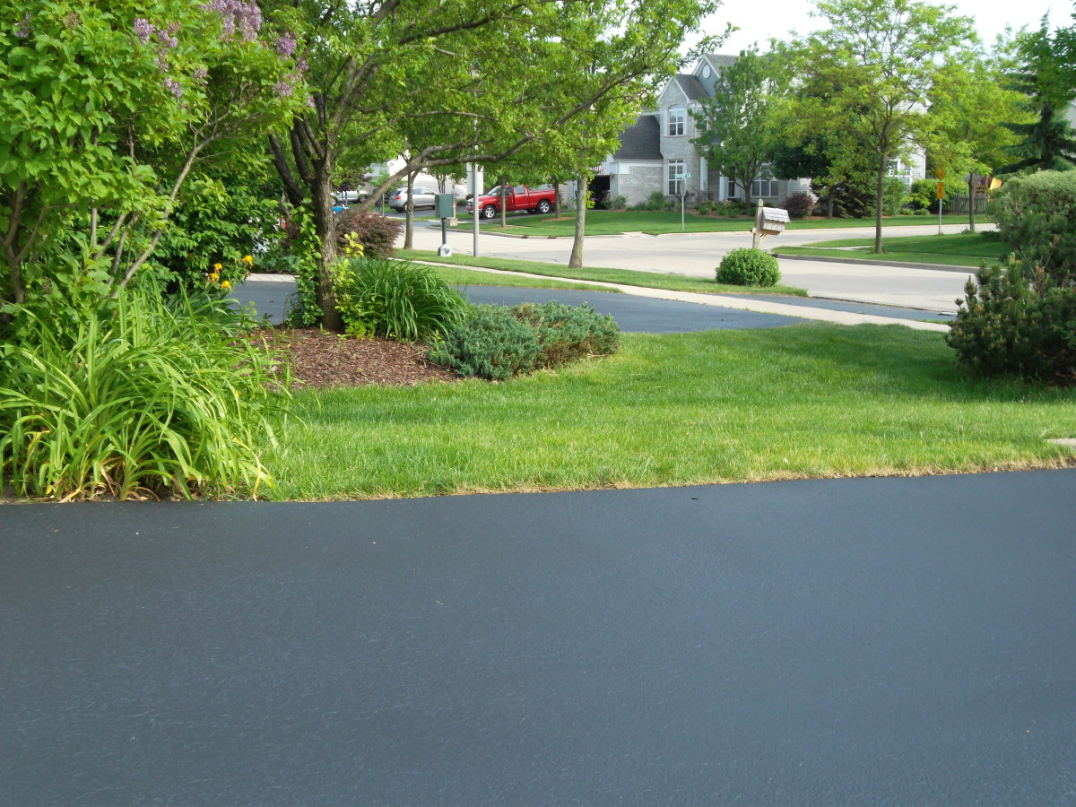 Pressure washing a driveway and sealing it can extend its life