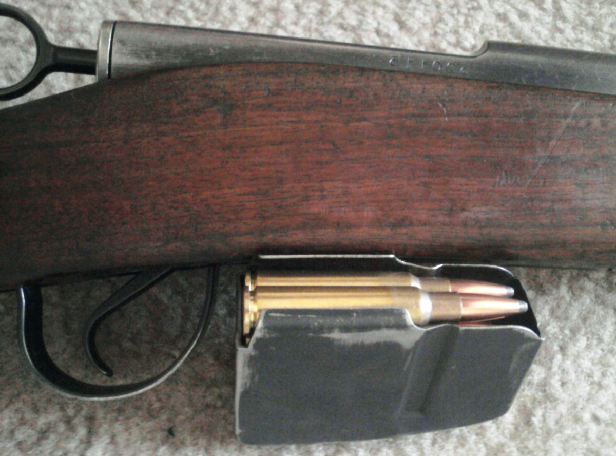 K-31 action and loaded magazine