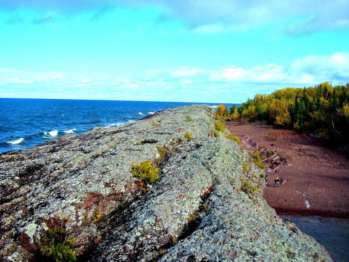a long strip of upthrust rock running along the Lake Superior shore line in Michigan's Keweenaw Peninsula