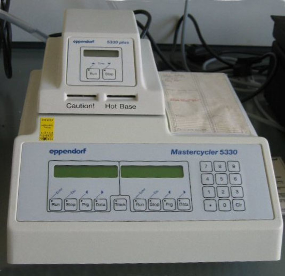 A PCR thermocycler, used to control the temperature cycles for amplifying DNA sequences.