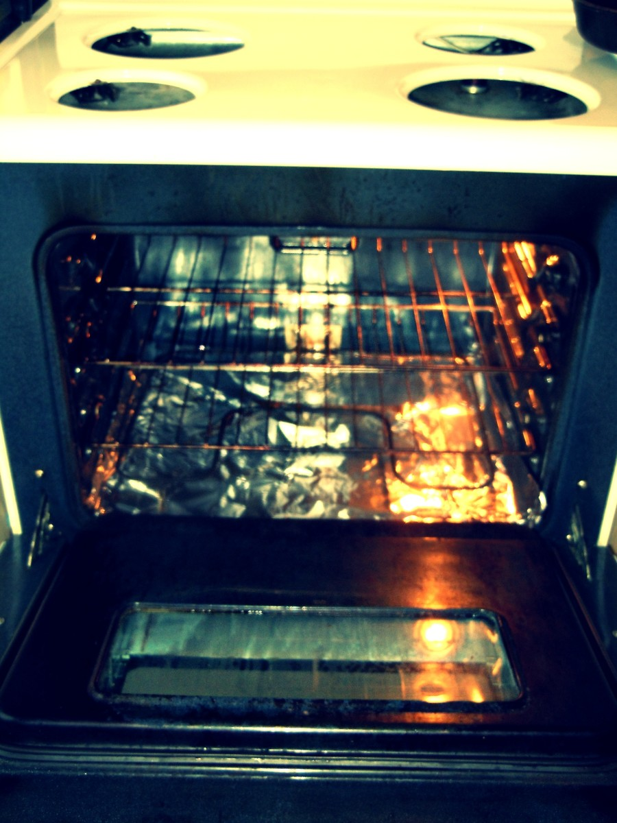 Two sheets of tin foil spread at bottom of oven to conveniently trash away from spills.