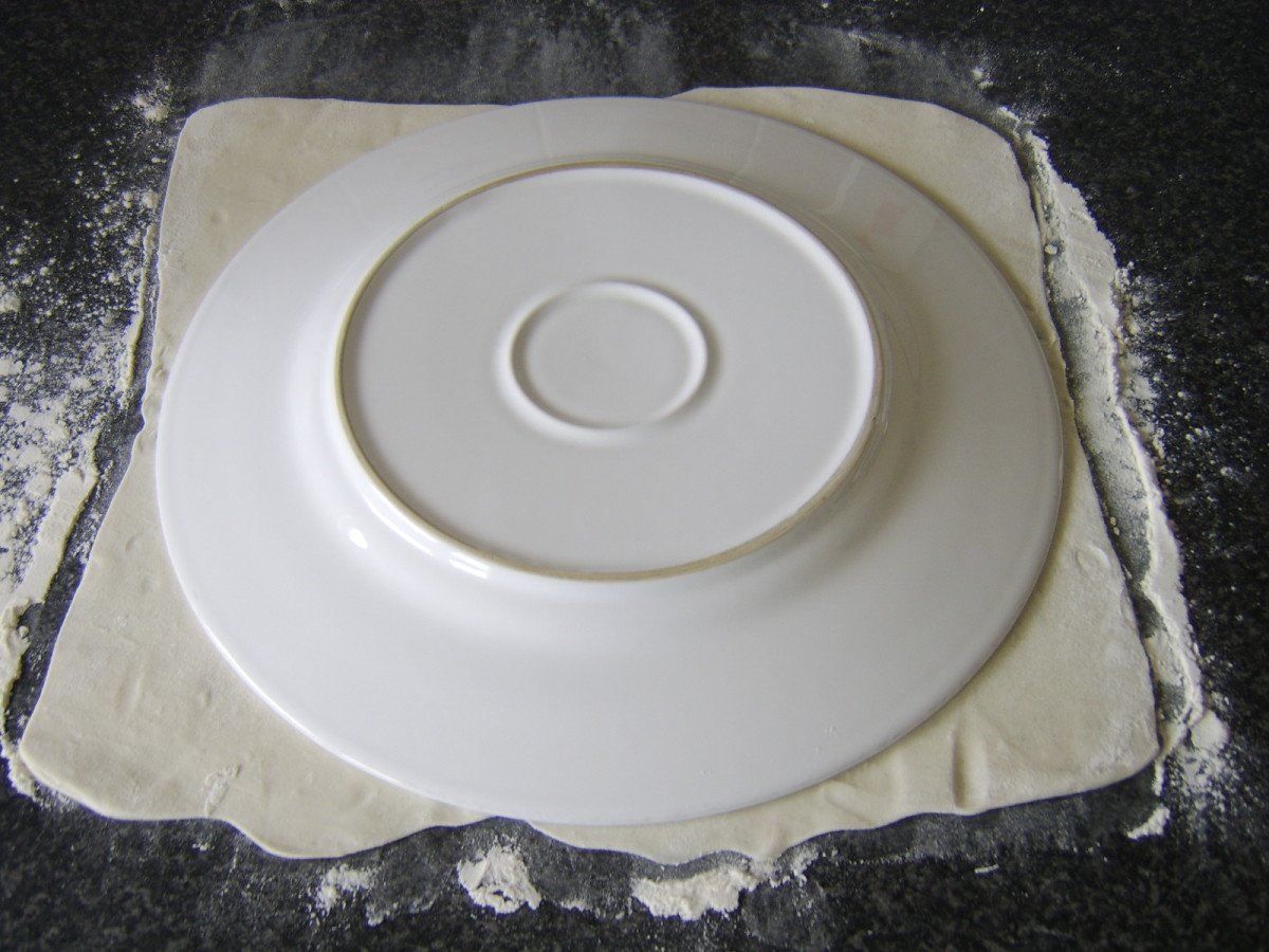 Disc is cut from rolled pastry