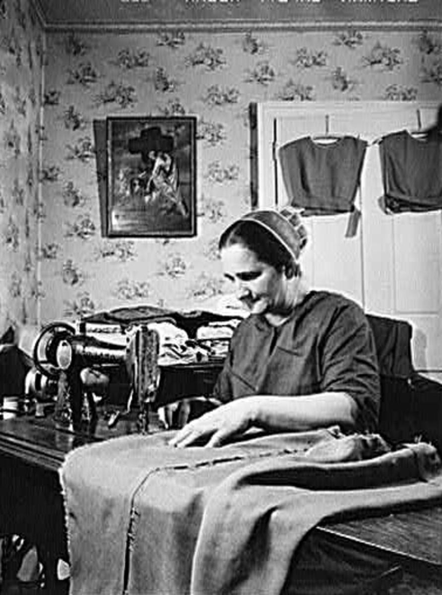 Mennonite woman sewing at home.