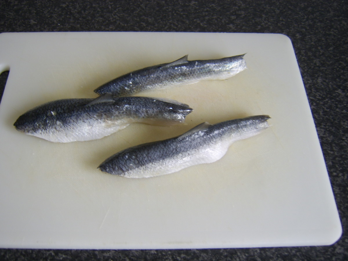 The dorsal fins can clearly be seen still to be in place on these herring fillets