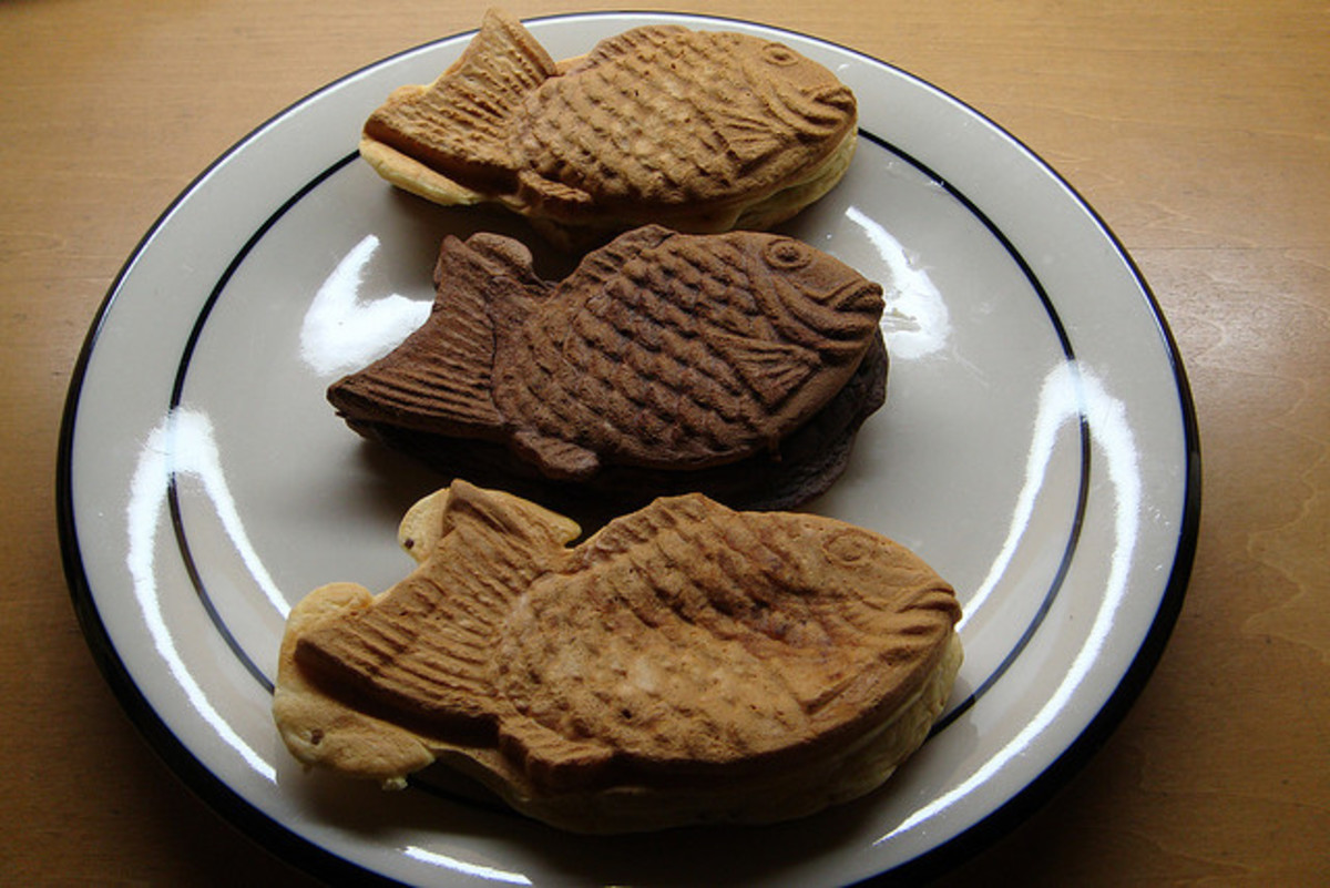 Taiyaki. The middle one is filled with dark chocolate and was thus made with a darker dough to differentiate it from the others.