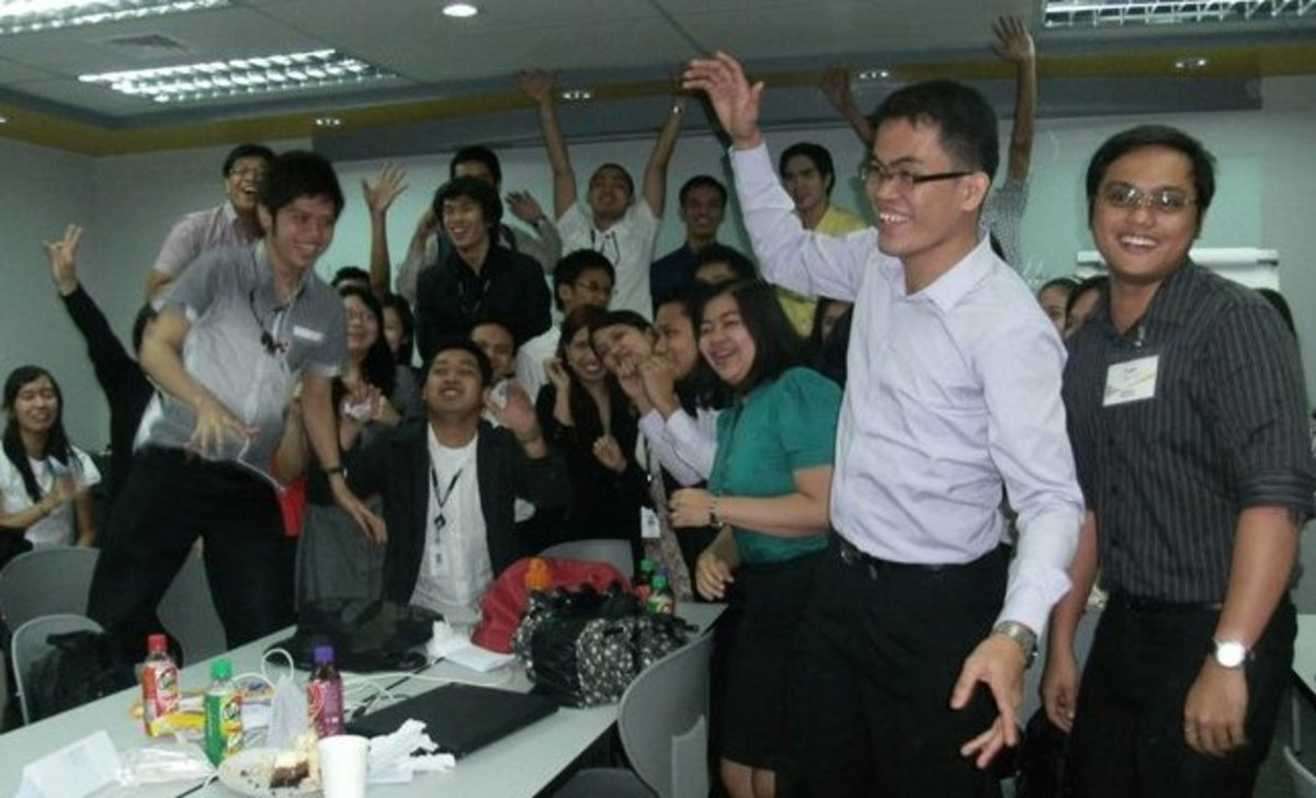 Dennis Magallanes, hamming it up with other SGV auditors at the corporate office in Makati