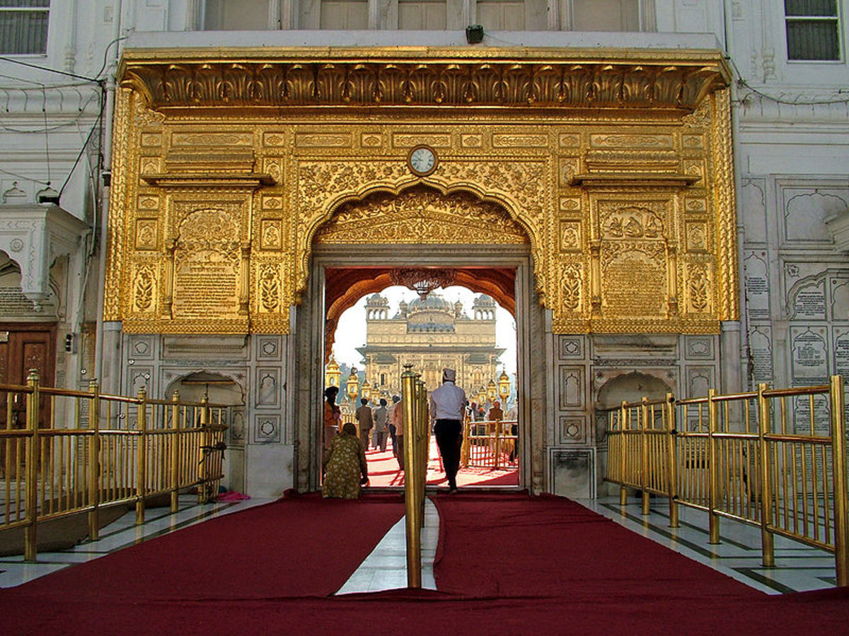 the main entrance to the Golden temple - starting with the 200 feet long pathway leading to the temple further up.