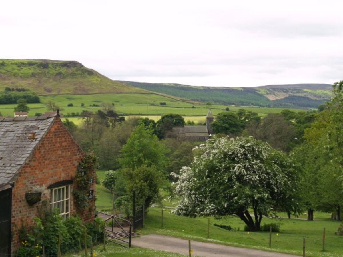 View from Bank Top Farm over the church to the Cleveland Hills