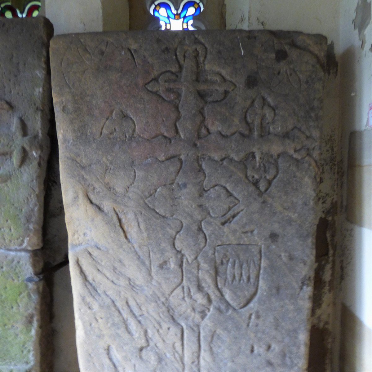Ornate slabs in the church porch are in fact coffin lids of the Percy family, whose lands extended across the North and North East, and who were involved with the Pigrimage of Grace (to the west near Northallerton)
