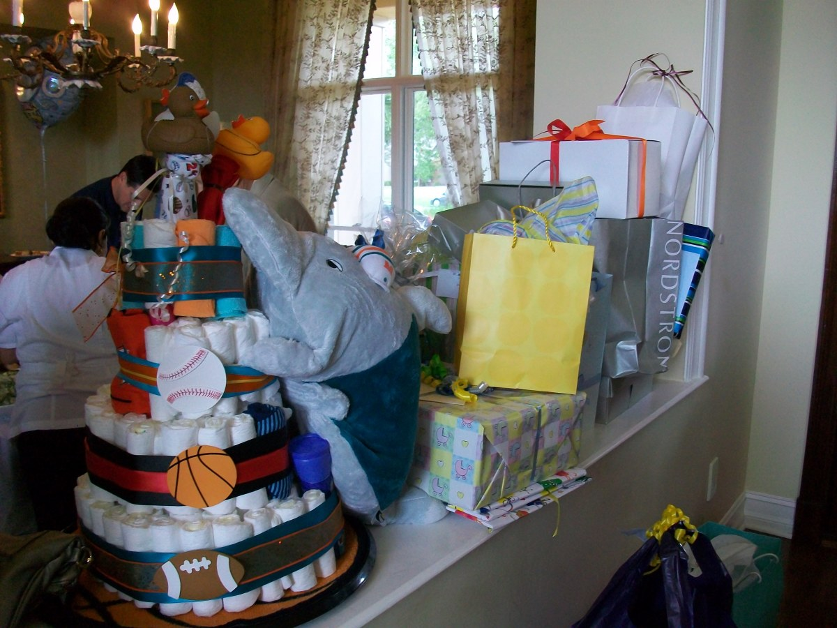 A pile of presents at a bris (brit milah). Because traditional Jews do not have baby showers, the mom's friends made a diaper cake for this occasion, instead.
