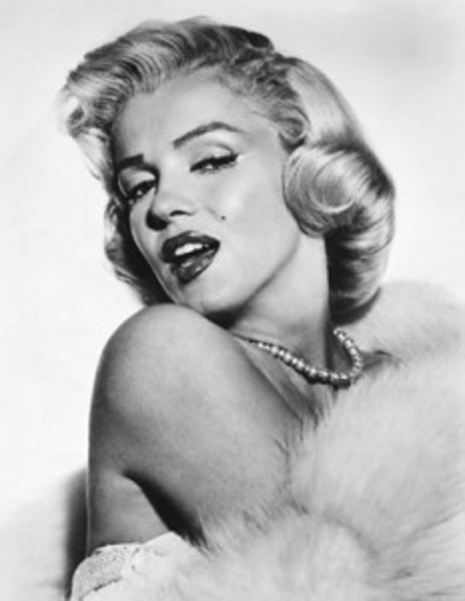 "Marilyn Monroe ""Imperfection is beauty, madness is genius and it's better to be absolutely ridiculous than absolutely boring."""